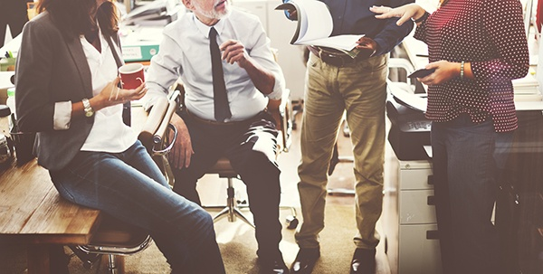 group in office around printer
