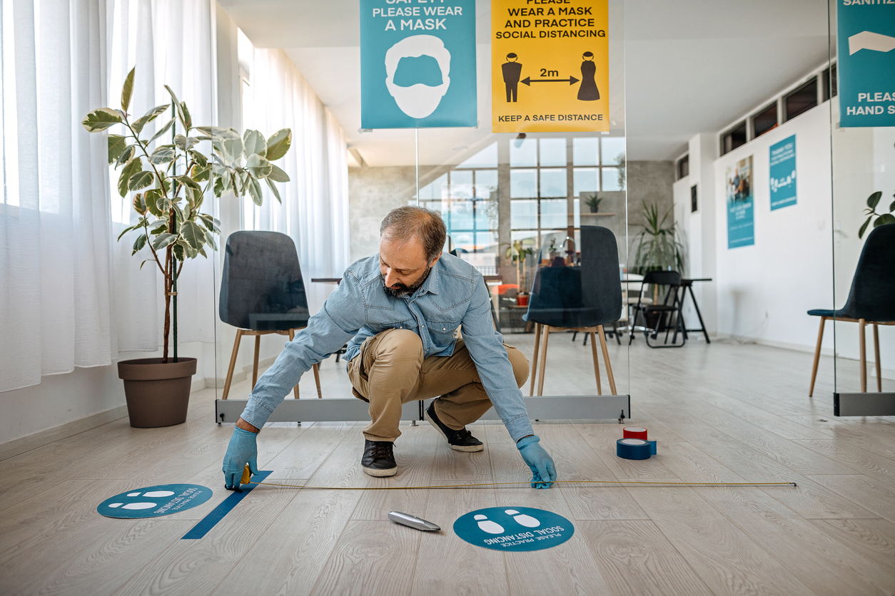 MIller's applies COVID floor signs