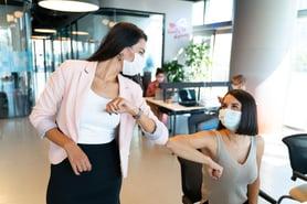 Millers blog 2 women elbow bump