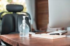 Millers blog sanitizer on desk