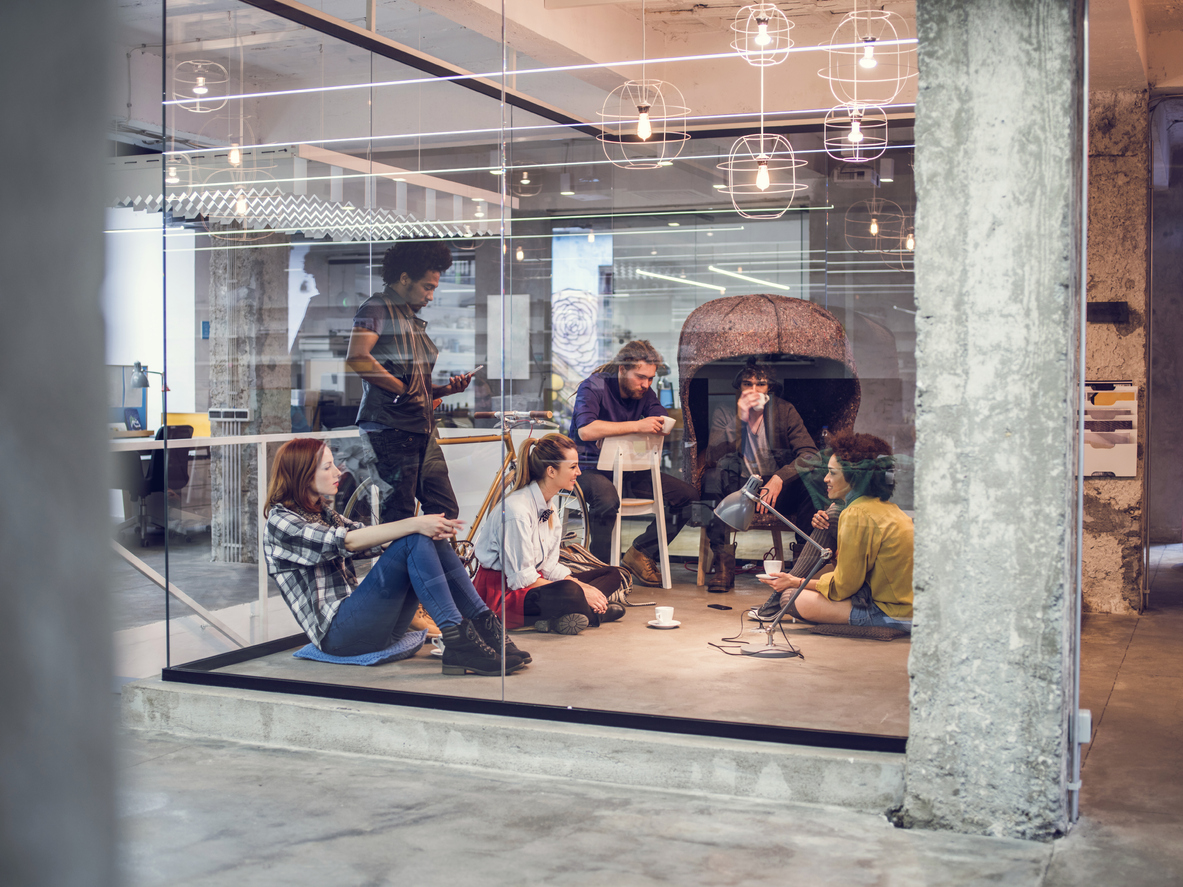 modern creative space with workers meeting